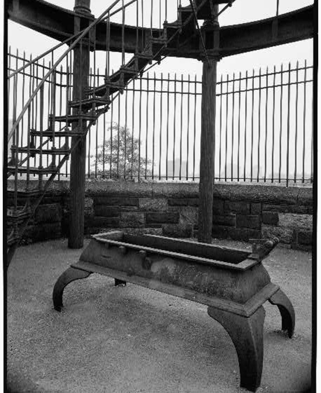 Photo of the base of the Harlem Fire Watchtower and automatic bell ringer taken for the HAER Study.