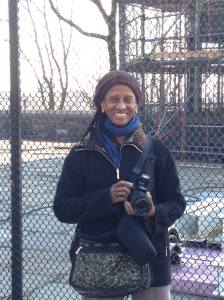 MGPAlliance Secretary Cynthia M. Reed, camera in hand documenting the restoration of the fire watchtower that sits atop of Mount Morris in Marcus Garvey Park.