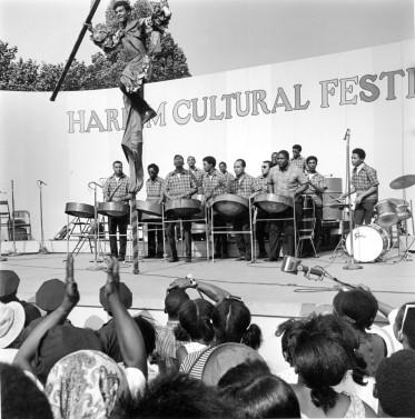 53198-16_Harlem Cultural Festival, stilt dance to steel drums, Mt Morris Park_7-28-1968_Daniel McPartlin